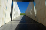 modern walkway to Canberra Parliament House poster