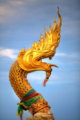 Large statue of golden snake / dragon creature