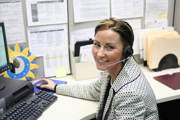 Beautiful female call center operator, headset customer srvice