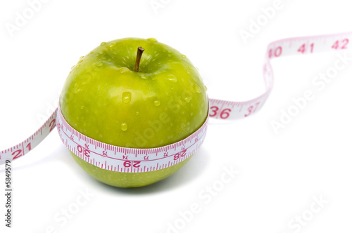 Green apple with measuring tape. Weight loss concept.
