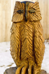 a statue of an owl carved out of wood