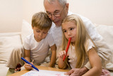 Grandpa is teaching his grandchildren to draw    poster