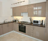 Modern kitchen interior with integrated appliances poster