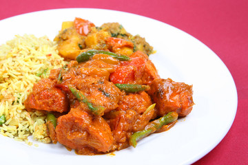 Chicken Jalfrezi with pilau rice and Bombay aloo