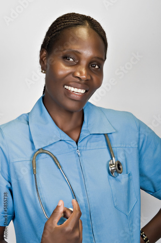 Portrait of African nurse, in blue with stethoscope