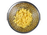 Penne pasta draining in a colander poster