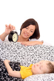 mother trying to wake up 4 years old boy poster