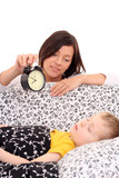mother trying to wake up 4 years old boy /focus on mother/ poster