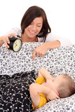 mother trying to wake up 4 years old boy /focus on child/ poster