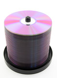 Colorful purple DVDs or CDs on spindle. No dust. poster