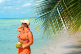 voluptuous woman holding coconut with palm backdrop  poster
