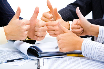 People with their thumbs up meaning a great business plan