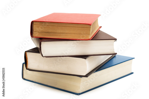 Leinwanddruck Bild Four books isolated on the white background