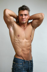 Stretching muscular male model