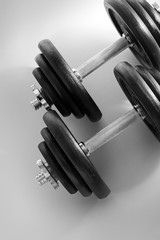 Black & white image of a pair of dumbells