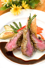 Crusted lamb chops served with zucchini and peppers