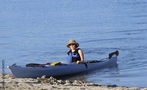 An attractive young woman after a kayak ride