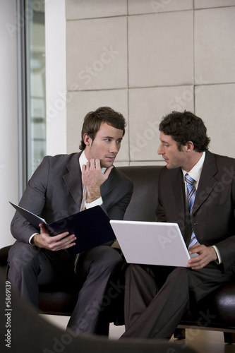 Young businessmen discussing strategy