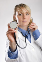 Female Doctor Hand Held Stethoscope close up