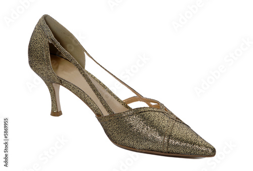 Golden shiny woman shoes isolated on white