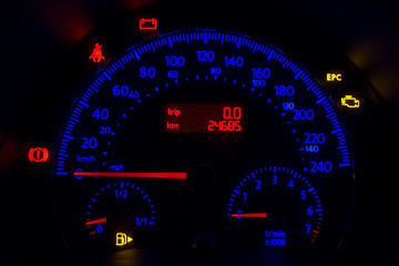 odometer of european car in red and blue