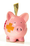 Piggy bank with bandage and a dollar poster