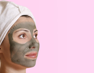 Female with a clay beauty mask and space for  message.