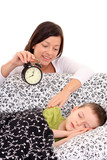 mother trying to wake up 6 years old boy /focus on woman/ poster