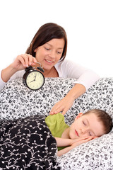 mother trying to wake up 6 years old boy /focus on woman/