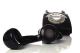 Retro black phone with focus on the handset in the foreground. poster