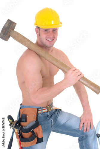 Handsome young topless construction worker with hammer