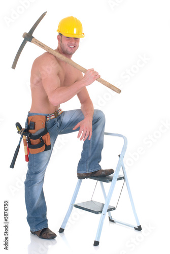 Handsome young topless construction worker with pickax,