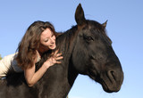 young woman and stallion poster