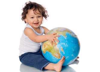Happy baby with globe.