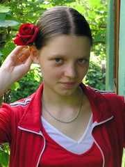 OLYMPUS DIGITAL CAMERA. The girl with a rose lovely smiles