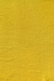 Yellow colored plain cotton linen as background poster