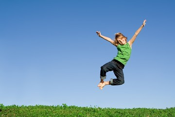 happy smiling child jumping for joy