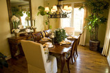 Dining room with a hardwood floor. poster