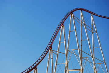 rollercoaster frame against blue sky