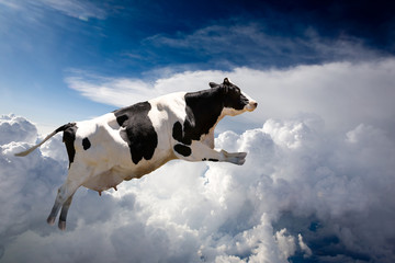 A super cow flying over clouds