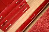 Details of red drawer in sitting-room, wooden interior poster