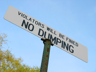 """NO DUMPING - VIOLATORS WILL BE FINED""."
