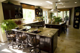 Luxury kitchen with a granite breakfast counter. poster