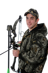 Young hunter with camo and bow and arrow