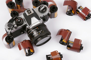 Closeup image of 35mm films and a SLR Camera.