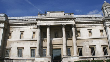 entrance with columns and balustrade. windows