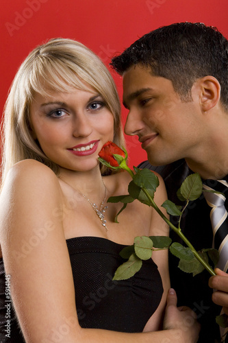 Handsome man is giving beautiful woman one rose