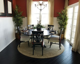 Elegant Forming Dining Area with hardwood flooring poster