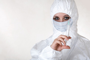 Doctor in white coat and mask with syringe.