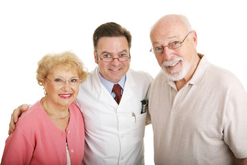 Senior couple in their new glasses with their optometrist.